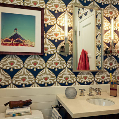 Inspiration for a small eclectic white tile and subway tile limestone floor and beige floor bathroom remodel in Los Angeles with flat-panel cabinets, medium tone wood cabinets, a two-piece toilet, multicolored walls, an undermount sink and limestone countertops
