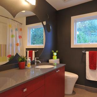 Modernes Badezimmer mit Unterbauwaschbecken, flächenbündigen Schrankfronten, roten Schränken, schwarzer Wandfarbe und grauer Waschtischplatte in Vancouver