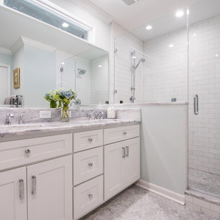 Mid-sized elegant master white tile and subway tile mosaic tile floor alcove shower photo in Charleston with shaker cabinets, white cabinets, blue walls, an undermount sink and marble countertops