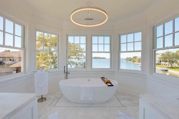 Beach Style Bathroom by Advanced Home Audio