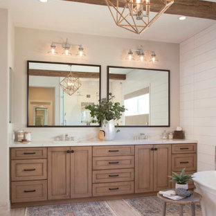 Inspiration for a large cottage master white tile and ceramic tile porcelain tile and beige floor bathroom remodel in San Diego with recessed-panel cabinets, distressed cabinets, a two-piece toilet, white walls, an undermount sink, quartz countertops, a hinged shower door and white countertops