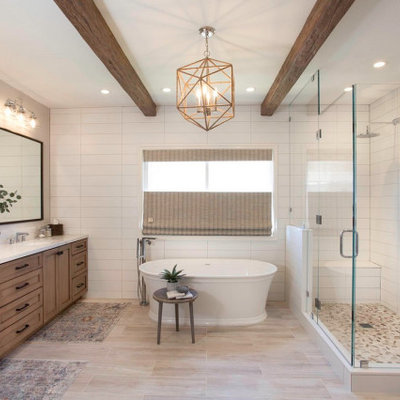 Large beach style master white tile and ceramic tile porcelain tile and beige floor bathroom photo in San Diego with recessed-panel cabinets, beige cabinets, a two-piece toilet, white walls, an undermount sink, quartz countertops, a hinged shower door and white countertops