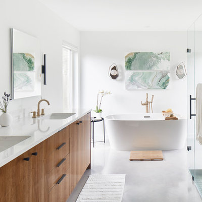 Inspiration for a large contemporary master white tile and ceramic tile white floor and concrete floor bathroom remodel in Austin with flat-panel cabinets, medium tone wood cabinets, white walls, an undermount sink, a hinged shower door, white countertops, a two-piece toilet and quartz countertops