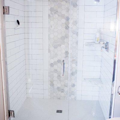 Example of a large trendy 3/4 white tile and stone tile vinyl floor walk-in shower design in Other with recessed-panel cabinets, brown cabinets and gray walls