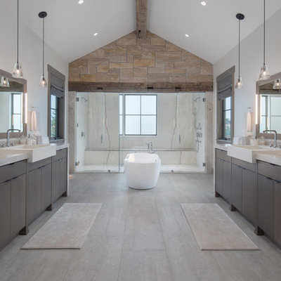 Inspiration for a rustic master beige floor bathroom remodel in Other with flat-panel cabinets, dark wood cabinets, a vessel sink, white walls, quartzite countertops and gray countertops