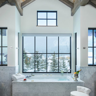 Inspiration for a rustic bathroom remodel in Other with an undermount tub and white walls