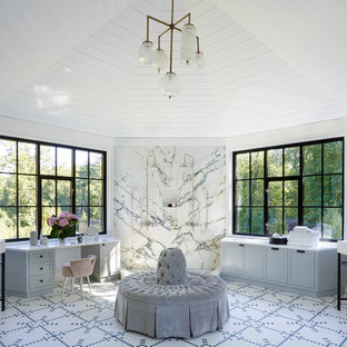 Inspiration for a large beach style master black and white tile multicolored floor bathroom remodel in Other with shaker cabinets, blue cabinets, blue walls, an undermount sink and white countertops
