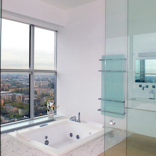 Example of a mid-sized trendy master light wood floor drop-in bathtub design in Miami with a wall-mount sink and white walls