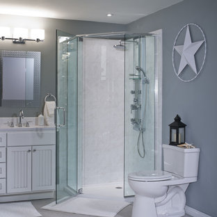Photo of a mid-sized modern 3/4 bathroom in Other with louvered cabinets, white cabinets, a corner shower, a two-piece toilet, white tile, ceramic tile, grey walls, ceramic floors, an undermount sink and laminate benchtops.