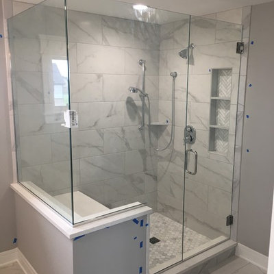 Corner shower - mid-sized contemporary master gray tile, white tile and marble tile marble floor and white floor corner shower idea in Chicago with gray walls and a hinged shower door