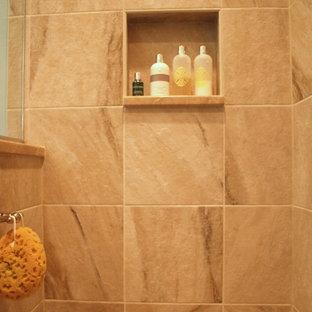ニューアークの小さいトラディショナルスタイルのおしゃれなマスターバスルーム (フラットパネル扉のキャビネット、濃色木目調キャビネット、オープン型シャワー、一体型トイレ、ベージュのタイル、セラミックタイル、青い壁、セラミックタイルの床、アンダーカウンター洗面器、御影石の洗面台、ベージュの床) の写真