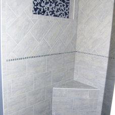 Eclectic Bathroom by Hertzler Brothers Inc.