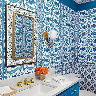Mid-sized tuscan 3/4 cement tile bathroom photo in San Diego with recessed-panel cabinets, blue cabinets, a two-piece toilet, multicolored walls, an undermount sink and terrazzo countertops