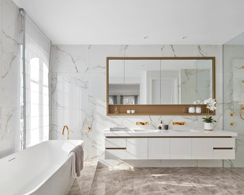 Trendy Master Black And White Tile Brown Floor Bathroom Photo In Melbourne  With Flat Panel