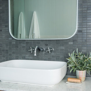Inspiration for a contemporary bathroom in Sydney with light wood cabinets, stone tile, grey walls, a vessel sink and engineered quartz benchtops.