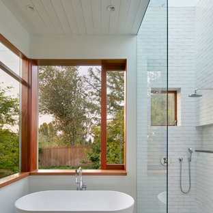 Example of a trendy master white tile concrete floor bathroom design in San Francisco with white walls