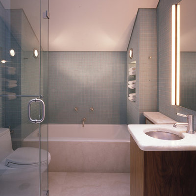 Example of a trendy blue tile and mosaic tile bathroom design in San Francisco with an undermount sink, flat-panel cabinets, dark wood cabinets and a one-piece toilet