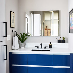 Inspiration for a mid-sized transitional 3/4 brown floor and single-sink bathroom remodel in DC Metro with flat-panel cabinets, blue cabinets, gray walls, an undermount sink, white countertops and a floating vanity