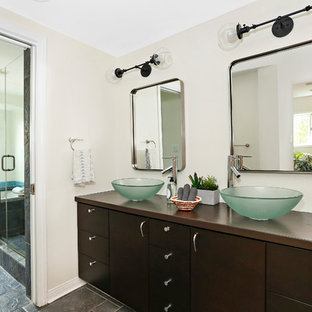 Bathroom - transitional master blue tile and mosaic tile gray floor bathroom idea in Los Angeles with flat-panel cabinets, dark wood cabinets, beige walls, a vessel sink, wood countertops, a hinged shower door and brown countertops