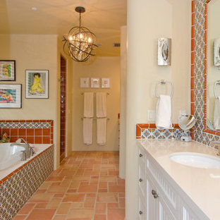 Medium sized bathroom in Phoenix with a submerged sink, recessed-panel cabinets, white cabinets, limestone worktops, a built-in bath, an alcove shower, beige walls, terracotta flooring and multi-coloured tiles.