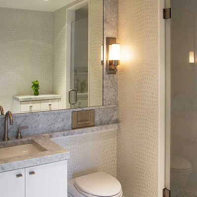 Alcove shower - mid-sized contemporary 3/4 gray tile marble floor alcove shower idea in Boston with an undermount sink, flat-panel cabinets, white cabinets, a wall-mount toilet and marble countertops
