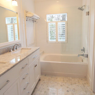 Inspiration for a small timeless white tile and ceramic tile marble floor bathroom remodel in Atlanta with an undermount sink, flat-panel cabinets, white cabinets, marble countertops, a two-piece toilet and white walls