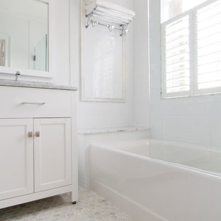 Bathroom - small traditional white tile and ceramic tile marble floor bathroom idea in Atlanta with an undermount sink, flat-panel cabinets, white cabinets, marble countertops, a two-piece toilet and white walls