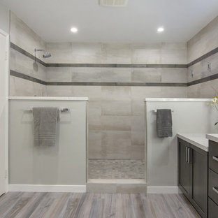Inspiration for a mid-sized contemporary master gray tile and porcelain tile porcelain tile and gray floor bathroom remodel in San Diego with shaker cabinets, gray cabinets, a one-piece toilet, gray walls, an undermount sink and quartz countertops
