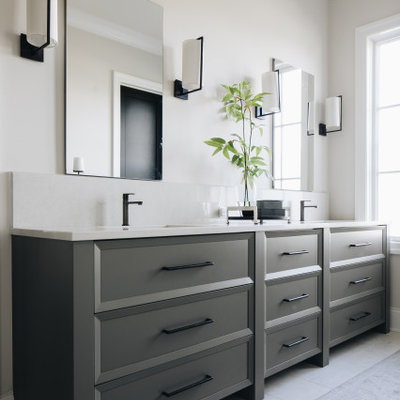 Example of a transitional master white floor and double-sink bathroom design in Chicago with recessed-panel cabinets, gray cabinets, beige walls, quartz countertops, white countertops and a built-in vanity