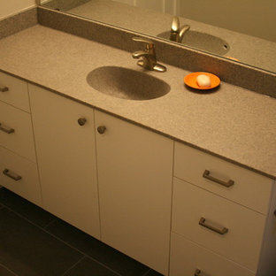 Bathroom - modern gray floor bathroom idea in Minneapolis with flat-panel cabinets, white cabinets and beige walls