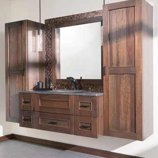 Design ideas for a mid-sized transitional master bathroom in Boston with flat-panel cabinets, medium wood cabinets, brown tile, metal tile, white walls, porcelain floors, an undermount sink, solid surface benchtops, grey floor and multi-coloured benchtops.