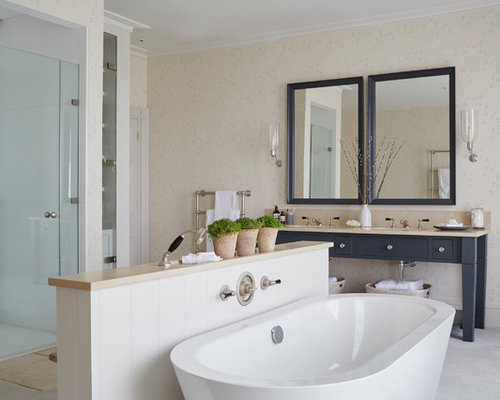 Photo Of A Classic Ensuite Bathroom With Flat Panel Cabinets, Blue  Cabinets, A