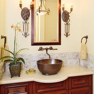 サンフランシスコの巨大な地中海スタイルのおしゃれなバスルーム (浴槽なし) (ベッセル式洗面器、レイズドパネル扉のキャビネット、濃色木目調キャビネット、珪岩の洗面台、白いタイル、メタルタイル、ベージュの壁) の写真