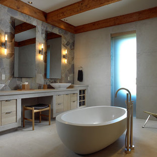 Mid-sized mountain style master multicolored tile and slate tile ceramic floor and beige floor bathroom photo in Other with flat-panel cabinets, light wood cabinets, a vessel sink, gray walls and concrete countertops