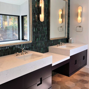 Mid-sized trendy master green tile and glass tile wood-look tile floor, brown floor, double-sink and vaulted ceiling bathroom photo in Other with flat-panel cabinets, black cabinets, white walls, an undermount sink, a hinged shower door, white countertops and a floating vanity