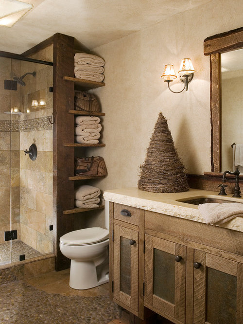 example of a mountain style beige tile and travertine tile pebble tile floor alcove shower design - Bathroom Ideas Rustic