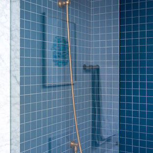 Alcove shower - small modern master blue tile and glass tile marble floor and gray floor alcove shower idea in Toronto with a hinged shower door, a wall-mount toilet, white walls, an undermount sink and marble countertops