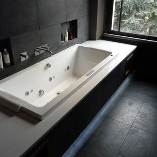 Photo of a medium sized contemporary ensuite bathroom in Other with engineered stone worktops, a built-in bath, black tiles, stone tiles, black walls and slate flooring.