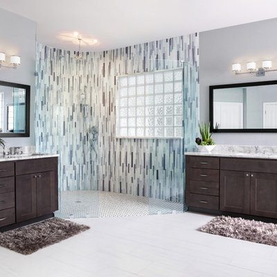 Mid-sized minimalist master gray tile and glass tile porcelain tile and white floor bathroom photo in Austin with shaker cabinets, gray cabinets, gray walls, an undermount sink, quartzite countertops and white countertops