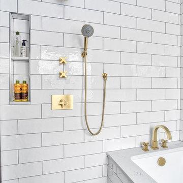 Sleek White and Brass Shower with Niche