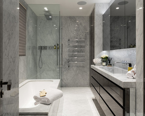 Modern Ensuite Bathroom In London With Flat Panel Cabinets, Black Cabinets,  A Submerged