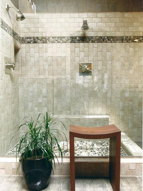 pebble tile floor and beige floor double shower idea in san francisco