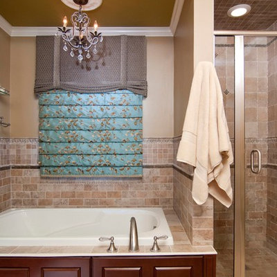 Bathroom - small traditional master ceramic tile and brown tile ceramic tile and beige floor bathroom idea in New York with dark wood cabinets, an undermount sink, raised-panel cabinets, marble countertops, a two-piece toilet, brown walls and a hinged shower door