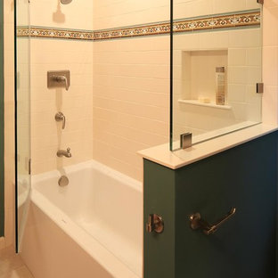Photo of a small mediterranean ensuite bathroom in San Francisco with a submerged sink, freestanding cabinets, medium wood cabinets, solid surface worktops, an alcove bath, a shower/bath combination, a two-piece toilet, beige tiles, ceramic tiles, green walls and ceramic flooring.