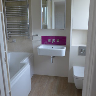 small bathroom design with shower bath and wall-hung suite