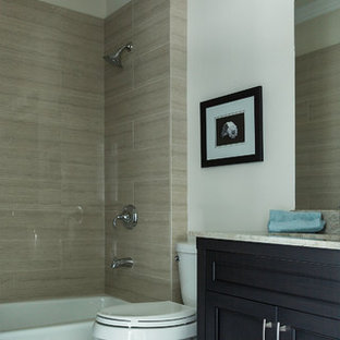 Example of a mid-sized transitional 3/4 stone tile limestone floor bathroom design in San Francisco with shaker cabinets, beige walls, an undermount sink, black cabinets, a two-piece toilet and granite countertops