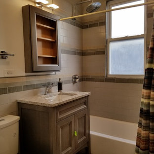 Bathroom - small modern 3/4 beige tile, brown tile and ceramic tile porcelain floor and beige floor bathroom idea in Chicago with furniture-like cabinets, medium tone wood cabinets, a two-piece toilet, beige walls, an undermount sink, granite countertops and multicolored countertops