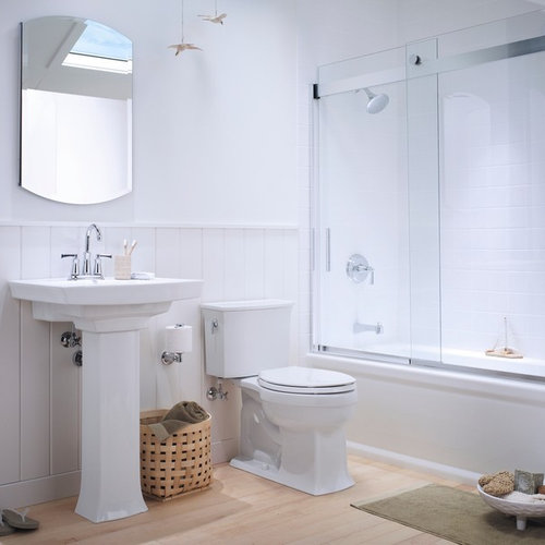 Example of a small classic light wood floor bathroom design in Milwaukee  with a pedestal sink