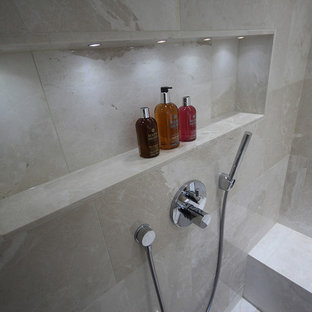 Design ideas for a small contemporary shower room in Surrey with a wall-mounted sink, dark wood cabinets, solid surface worktops, a walk-in shower, a wall mounted toilet, beige tiles, stone tiles, beige walls and marble flooring.