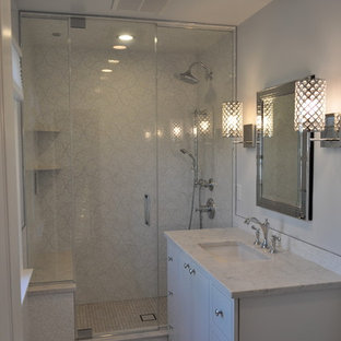 Photo of a mid-sized contemporary bathroom in New York with an undermount sink, furniture-like cabinets, white cabinets, engineered quartz benchtops, a two-piece toilet, multi-coloured tile, porcelain tile, grey walls, porcelain floors and with a sauna.